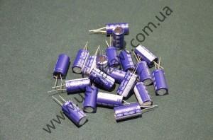 Электролитический конденсатор 400v100пкф
